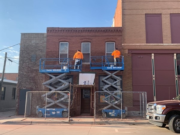 A new brick facade is being installed on the bookstore on 2nd Street