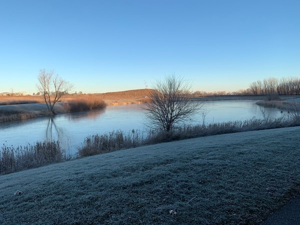 Prairie Lake is frosted over early in the morning